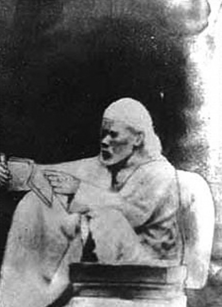 Shirdi_Sai_Baba_reading_